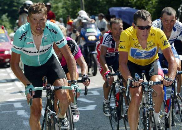 Das packendste Duell der Neuzeit Lance Armstrong (rechts) gegen Jan Ullrich.