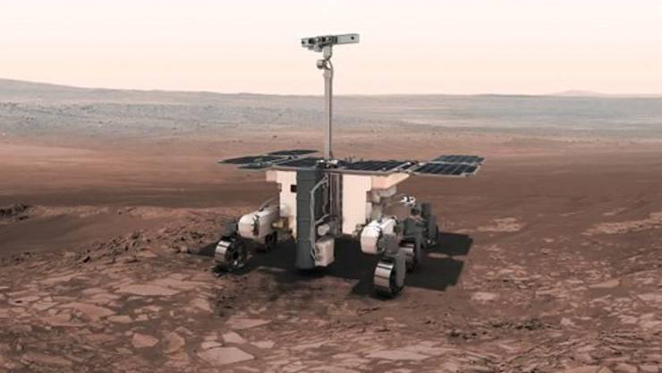 """Der Mars-Rover """"Rosalind Franklin"""" soll den Marsboden nach Spuren von Leben durchforsten. Damit seine Landung gelingt, müssen jedoch noch Probleme mit dem Fallschirmsystem gelöst werden."""