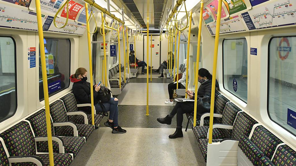 FILED - Passengers sit in an almost empty subway train on the District Line in central London. Photo: Dominic Lipinski/PA Wire/dpa