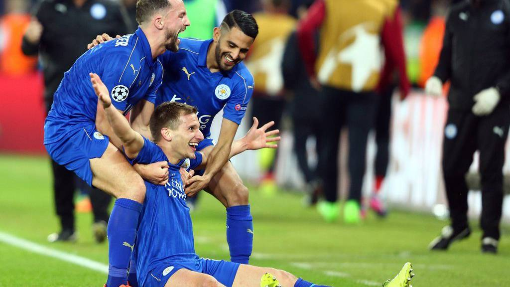 epa05848584 Leicester City's Marc Albrighton (down) celebrates after scoring the 2-0 goal during the UEFA Champions League Round of 16 second leg soccer match between Leicester City and Sevilla FC at the King Power Stadium in Leicester, Britain, 14 March 2017.  EPA/TIM KEETON