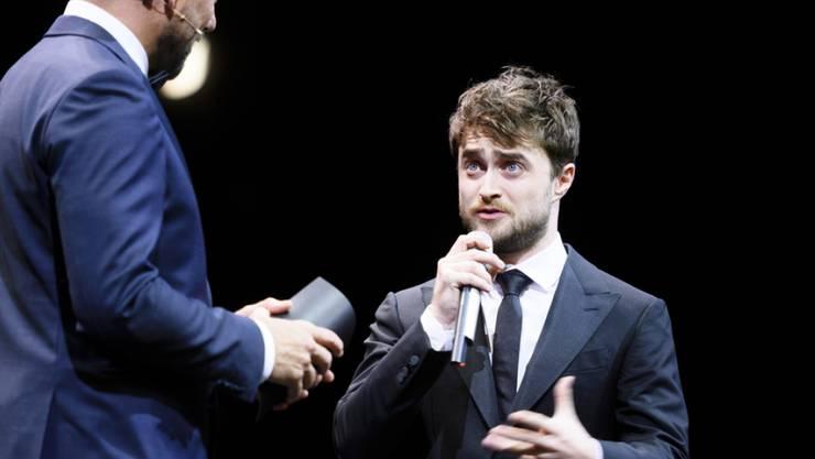 Für Daniel Radcliffe (r) ist es auch schwierig, berühmt zu sein. Hier gibt er Auskunft am Zurich Film Festival 2016 (Archiv)