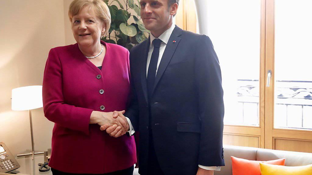 Bilaterales Treffen zwischen der deutschen Kanzlerin Angela Merkel und dem französischen Präsidenten Emmanuel Macron am Dienstag vor dem EU-Gipfel in Brüssel: Während Merkel den konservativen Spitzenkandidaten Manfred Weber unterstützt, lehnt Macron das Spitzenkandidaten-Modell grundsätzlich ab.
