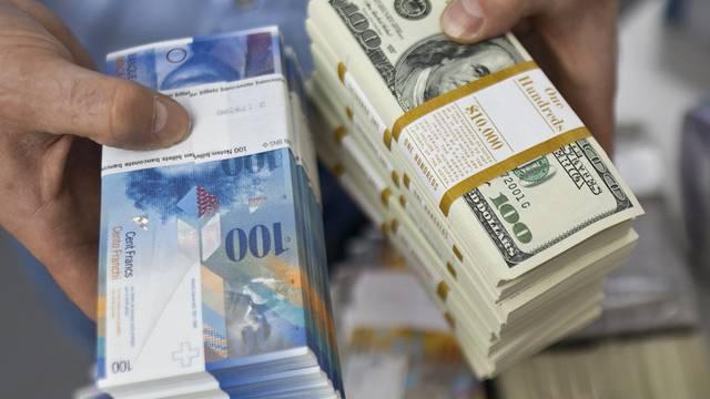Der Dollar-Franken-Wechselkurs klettert zum ersten Mal seit langem wieder über die Marke von 90 Rappen (Symbolbild)