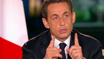 Frankreichs Präsident Nicolas Sarkozy verkündet sein Wahlprogramm am TV