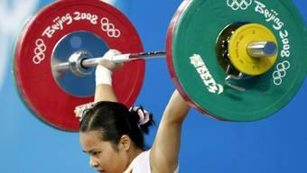 Drei chinesische Gewichtheberinnen, unter ihnen Chen Xiexia (im Bild), müssen ihre 2008 an den Olympischen Spielen in Peking gewonnen Goldmedaillen wegen Dopings zurückgeben