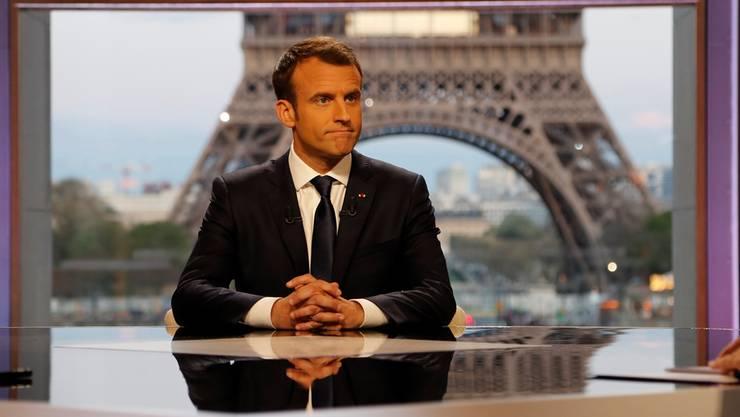 Macron gibt sich im TV-Interview schlagfertig und angriffslustig.EPA/Keystone