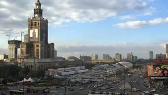 """""""Traum eines betrunkenen Konditors"""": Der monumentale Kulturpalast (links im Bild) im Zentrum Warschaus feiert seinen 60. Geburtstag. (Archiv)"""