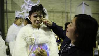 In China boomt der Kindermodel-Markt. Die Kids müssen bei Training und Arbeit so einiges einstecken können.