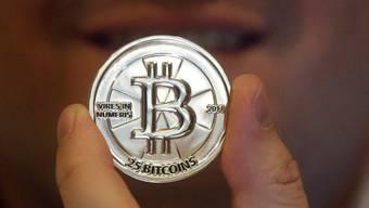 Enthusiasten sind davon überzeugt, dass die Technologie des Bitcoins ähnlich revolutionär ist wie das Internet. (Archivbild)