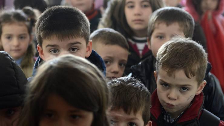 Kinder aus dem Kosovo, die flüchten mussten.