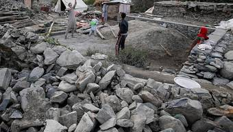 Erdbeben wie in Pakistan und andere Katastrophen erschütterten das Leben zahlreicher Menschen (Symbolbild).
