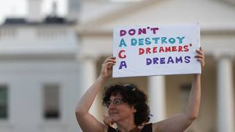 "Julia Paley, of Arlington, Va., with the DMV Sanctuary Congregation Network, holds up a sign that reads ""DACA Don't Destroy Dreamers Dreams"" during a rally supporting Deferred Action for Childhood Arrivals, or DACA, outside the White House, in Washington, Monday, Sept. 4, 2017. A plan President Donald Trump is expected to announce Tuesday for young immigrants brought to the country illegally as children was embraced by some top Republicans on Monday and denounced by others as the beginning of a ""civil war"" within the party. (AP Photo/Carolyn Kaster)"