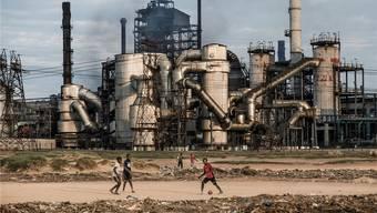 Müssen Mutterfirmen für Umweltschäden haften, welche ihre Tochterfirmen im Ausland verursachen?keystone