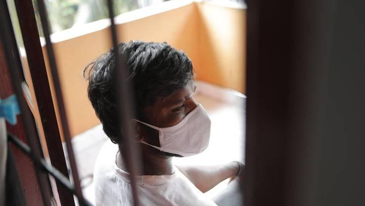 Prasad Dinesh wird von den Behörden mit fast der Hälfte der über 2600 Corona-Fälle in Sri Lanka in Verbindung gebracht: Dinesh sitzt in seinem Haus am 1. Juli 2020.