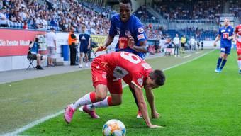 Der neue Modus soll für mehr Spannung sorgen. Hier im Bild Sven Joss vom FC Thun (vorne) gegen Luzerns Ibrahima Ndiaye. (Bild Martin Meienberger/Freshfocus)