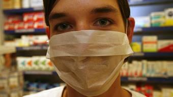 Ansteckungsgefahr: Im Herbst schon könnten Menschen mit Schutzmaske auch in der Region anzutreffen sein.