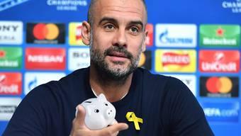 Was hat Pep Guardiola mit einem Sparschwein zu tun?