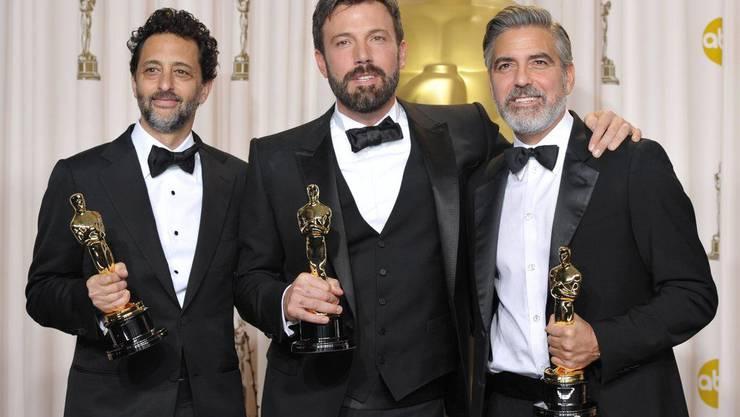 Die Macher des Siegerfilms «Argo»: Regisseur Ben Affleck (Mitte) und die Mit-Produzenten Grant Heslov und George Clooney.