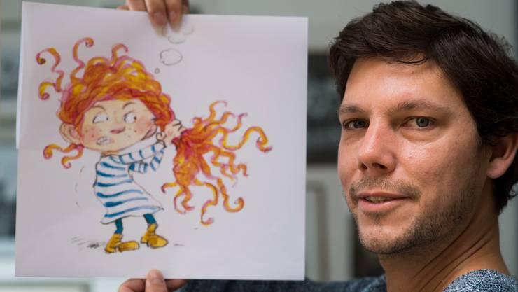 Simon Libsig mit Mimi, der Hauptfigur aus seinem neuen Kinderbuch.