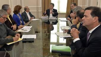 Zurück an den Verhandlungstisch: FARC-Vertreter und die kolumbianische Regierung haben die Friedensgespräche wiederaufgenommen.