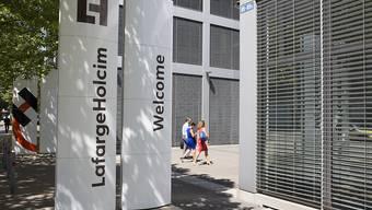 Nach Wertberichtgungen im Vorjahr hat der Baustoffkonzern LafargeHolcim 2018 wieder schwarze Zahlen geschrieben.