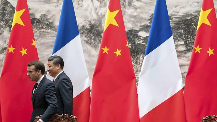 Präsidenten-Treffen mit indirekten wirtschaftlichen Folgen: Airbus bekommt einen Grossauftrag aus China. Im Bild sind Emmanuel Macron und Xi Jinping. (Symbol)