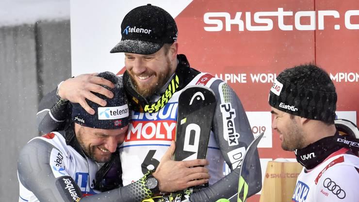 Gold und Silber für Norwegen: In seinem allerletzten Rennen wird die norwegische Ski-Legende Aksel Lund Svindal nur hachdünn von Landsmann Kjetil Jansurd geschlagen.
