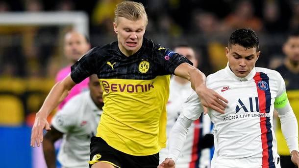 Mit Power: Erling Haaland (BVB, links) im Zweikampf mit Thiago Silva (PSG).