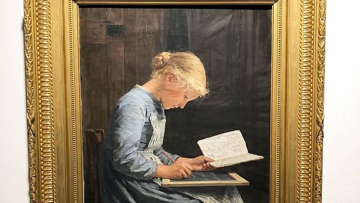 """Albert Ankers Porträt """"Fleissig/Appliquée"""" ist auf einer Auktion Schweizer Meisterwerke für 1.2 Millionen Franken versteigert worden."""