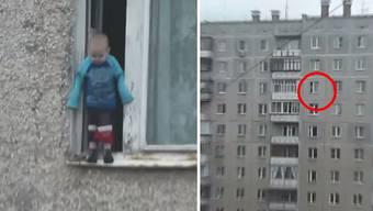 Nachdem sie die Polizei gerufen hatten, filmten Nachbarn die waghalsige Aktion des kleinen Vadik.