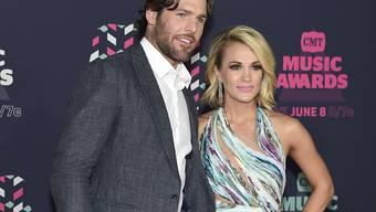 Bald erneut im Babyglück: US-Sängerin Carrie Underwood und ihr kanadischer Ehemann Mike Fisher. (Archivbild)