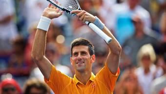 Novak Djokovic freut sich über seinen Sieg über Jérémy Chardy - und dass er der Marihuana-Wolke entfliehen darf.