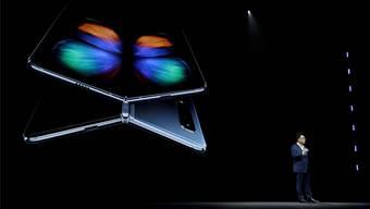 Premiere: Samsung-CEO Dong Jin Koh hat diese Woche ein faltbares Smartphone vorgestellt. Andere Hersteller werden nachziehen.
