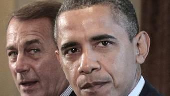 In Finanzfragen zerstritten: Boehner (l.) und Obama (Archiv)