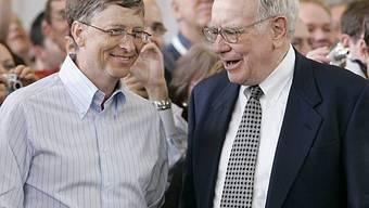 Bill Gates (l) und Warren Buffett - die Reichsten der USA (Archiv)