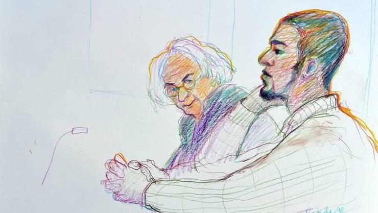 Brian, auch bekannt als Carlos, bei einer Verhandlung im Jahr 2015. Links neben ihm sein damaliger Verteidiger.