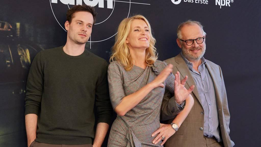 "Florian Bartholomäi, Maria Furtwängler and Axel Milberg posieren für die tausendste ""Tatort""-Folge."