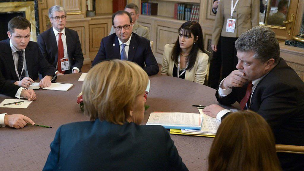 Anfang Oktober soll es zu einer Neuauflage des Gipfeltreffens zwischen Putin, Poroschenko, Merkel und Hollande kommen. (Archivbild)