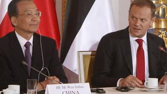 Wen Jiabao mit dem polnischen Premierminister Donald Tusk in Warschau