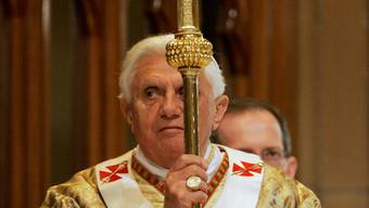 Pope Benedict XVI carries a ceremonial cross at a mass in Sydney's St Mary's Cathedral during World Youth Day  celebrations July 19, 2008. Pope Benedict apologised on Saturday for sexual abuse in the Catholic Church in Australia, saying those responsible should be brought to justice.  REUTERS/Will Burgess (AUSTRALIA)