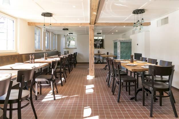 Die alten Holzwände wurden ins Säli des Restaurants integriert.