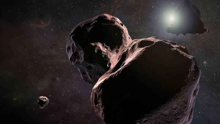 """Die Nasa-Raumsonde """"New Horizons"""" flog mit rund 51'500 Kilometern pro Stunde in rund 3500 Kilometern Abstand an """"Ultima Thule"""" vorbei. (Nasa-Illustration)"""