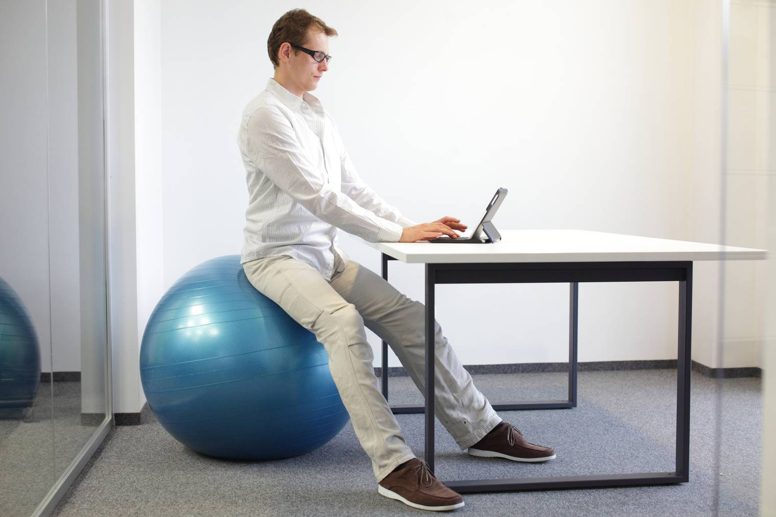 young man  - correct sitting position in office work