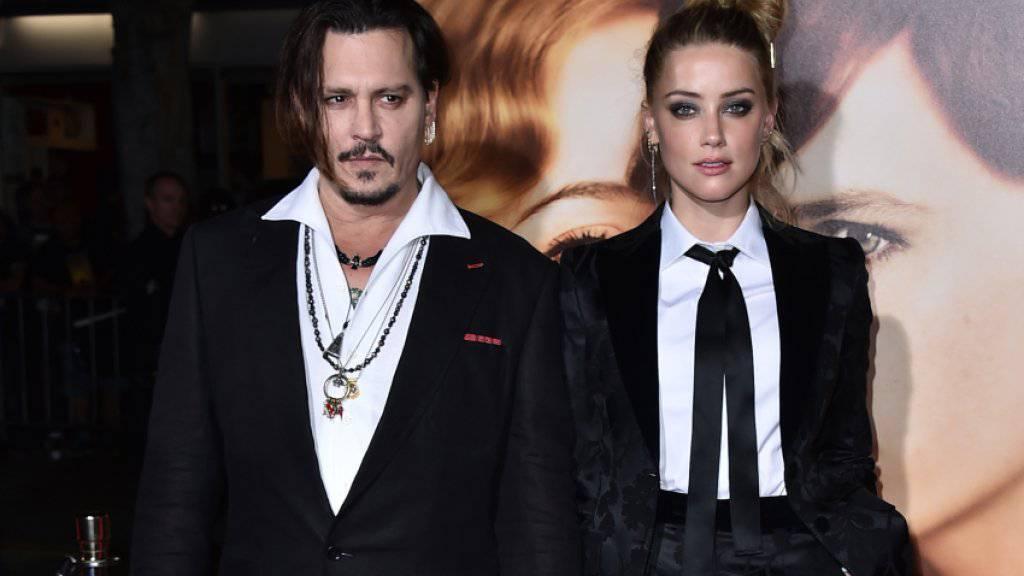 Werden beide vor Gericht in Australien erwartet wegen zweier Hunde: Johnny Depp und Amber Heard (Archiv)