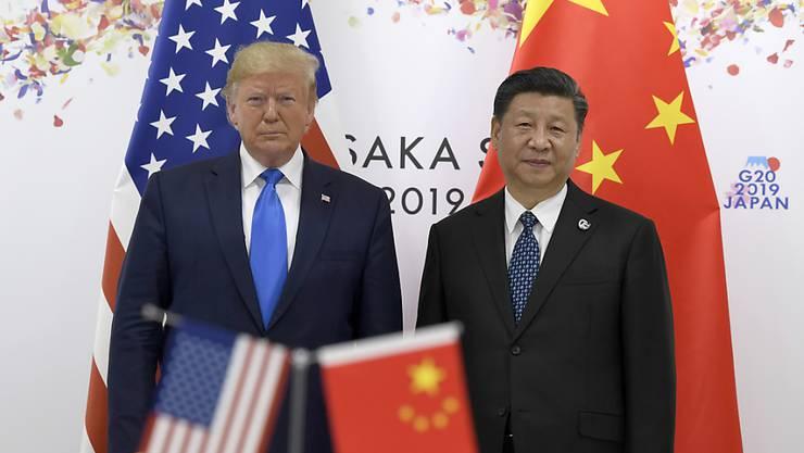 Die Spannungen zwischen China und den USA nehmen zu. Der chinesische Präsident Xi Jingping (rechts) fordert den amerikanischen Präsidenten Donald Trump auf, die Schulden bei der Uno zu begleichen. (Archivbild)