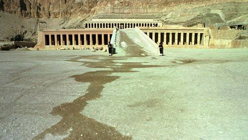 Two Egyptian soldiers stand guard Tuesday Nov 18 1997 in front of the temple of Hatshepsut, site of Monday's massacre in Luxor in which 58 tourists were killed by Muslim extremists. Several tour operators have announced that they are pulling back their tourists from Luxor.