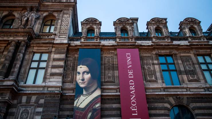 epa07940187 The poster announcing the exbition of the Italian Renaissance artist Leonardo Da Vinci hanges on the facade of the Louvre Museum in Paris, France, 22 October 2019. The exhbition running from 24 October 2019 to 24 February 2020 marks the 500th anniversary of Da Vinci's death. EPA/CHRISTOPHE PETIT TESSON