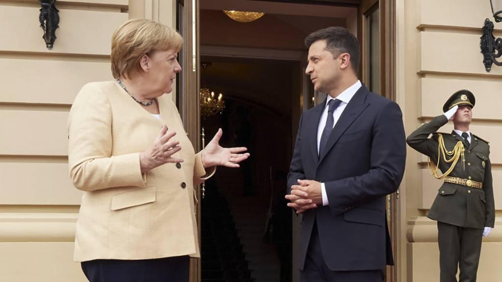 Merkel wirbt in Kiew für neuen Ukraine-Gipfel