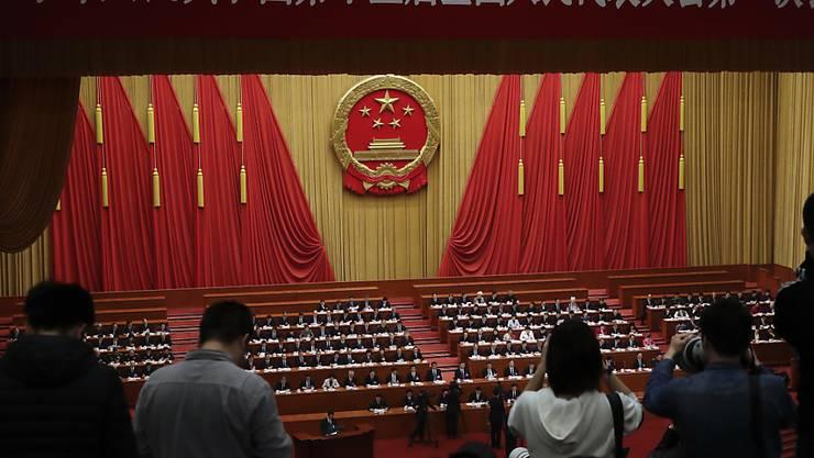 Grosser Staatsumbau geplant: Die chinesische Führung will die Zahl der Ministerien und Aufsichtsbehörden von 34 auf 26 reduzieren.