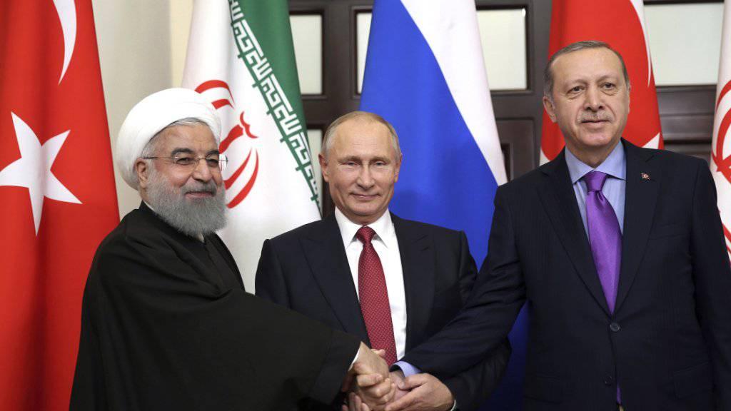 Die Präsidenten Irans, Russlands und der Türkei versuchen am heutigen Mittwoch erneut, eine politische Lösung für die Syrien-Krise zu finden. (Archivbild)
